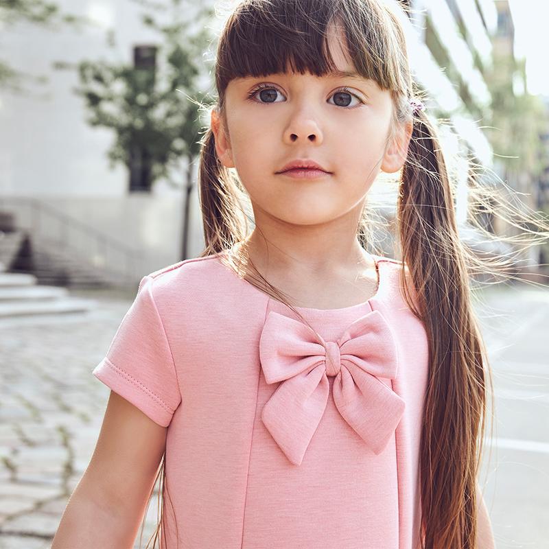girl wearing a pink festive dress